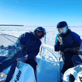 Two guys on snowmobiles at Gull Harbour