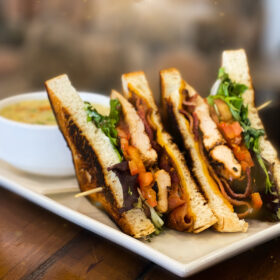 Mile high club house with grilled chicken and white bread